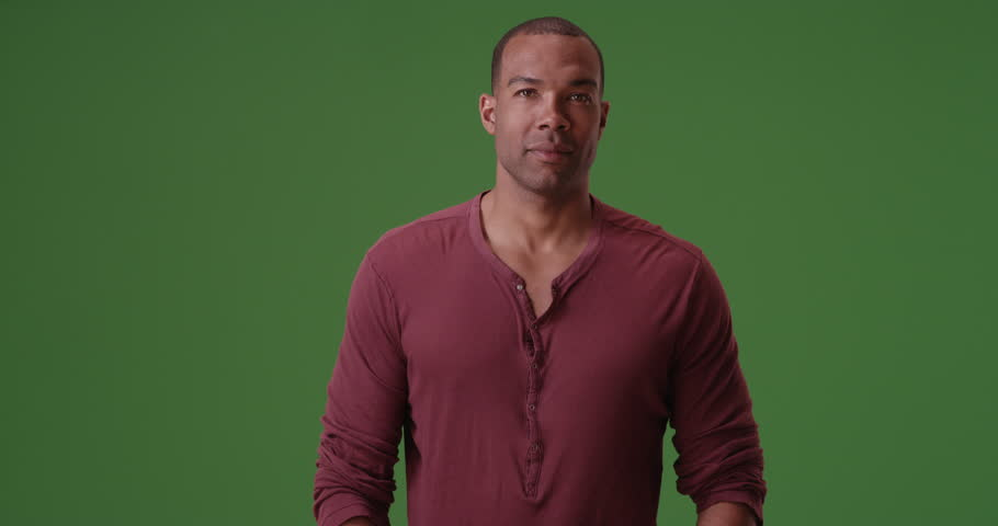 An African American man posing for a portrait on green screen. On green screen to be keyed or composited.
