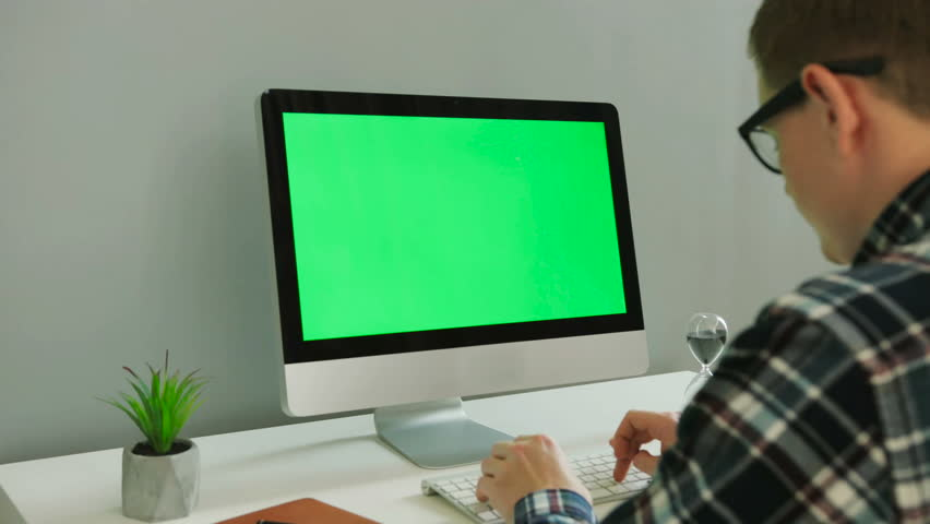 Close up shot of business man in the glasses using computer with green screen in the modern office. Chroma key. | Shutterstock HD Video #29854375