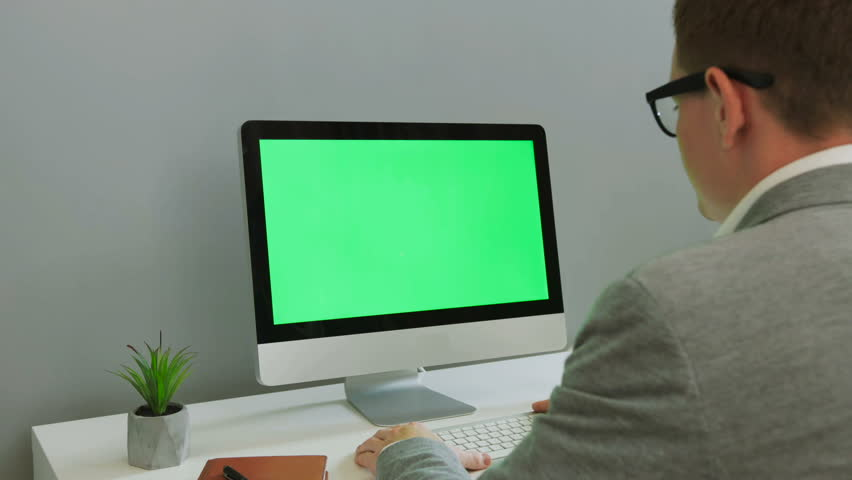 Back view of business man in the glasses working on computer with green screen in the modern office. Chroma key. | Shutterstock HD Video #29854408