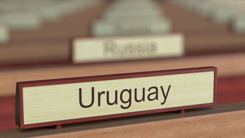 Uruguay name sign among different countries plaques at international organization. 3D rendering