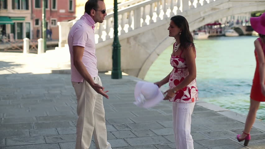 Rich couple fighting by the canal in Venice, slow motion