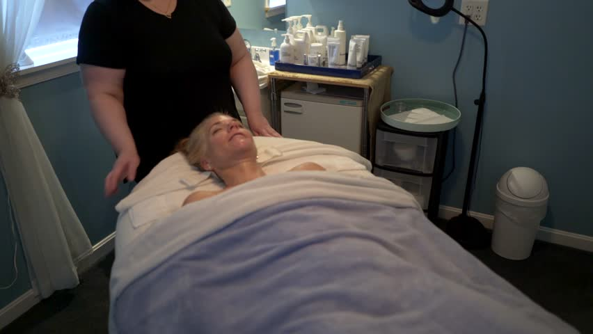 Masseuse and client both smile and laugh as the facial comes to its #29925400
