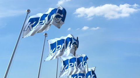 Waving flags with KPMG logo against sky, seamless loop. 4K editorial animation