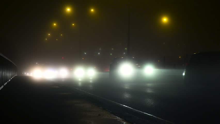 A Traffic At Fog Evening In Winter In Prague Cars driving through fog and bad weather in Fully Smog | Shutterstock HD Video #29955850