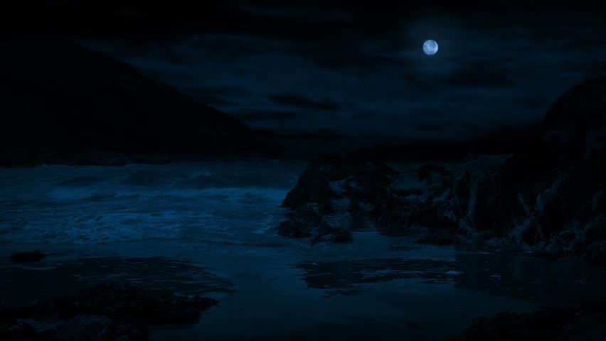 Waves Break On Rocky Beach In The Moonlight