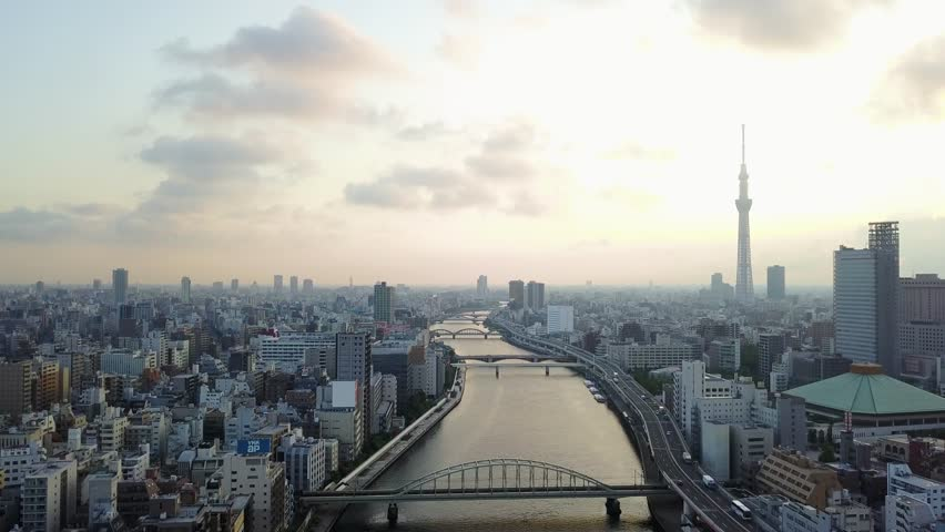 Aerial : Drone shooting of the landscape in Tokyo city Japan backward view Tokyo sky tree and the river and the bridge and roadway #30014530