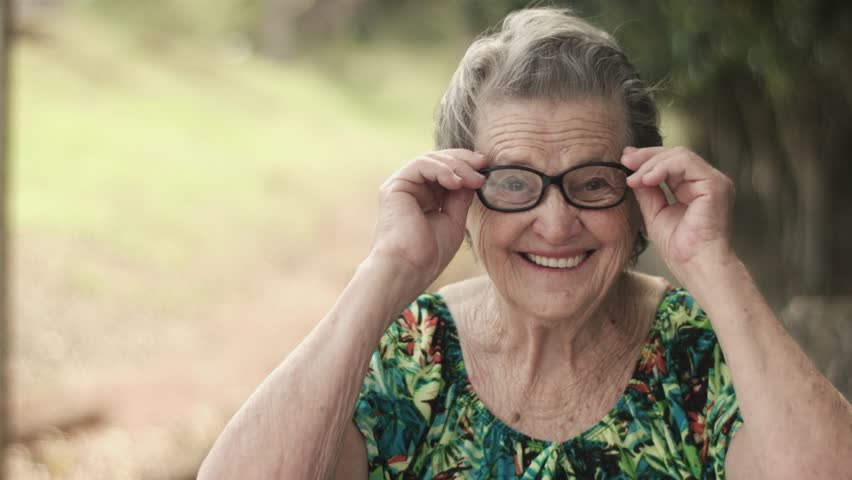 Joyful senior lady in glasses laughing