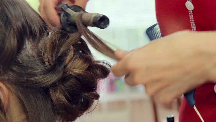Hair curling. hairdresser makes wedding hairstyle with curls.  | Shutterstock HD Video #30030397