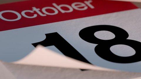 Paper tear off desk Calendar for October flipping through days of month
