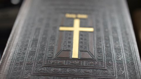 Antique Holy Bible with Gold Cross on Cover Shallow Depth of Field