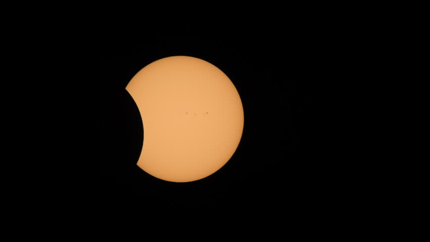 The Moon continues to pass the Sun's disk in the second partial eclipse phase of the Great American Eclipse on August 21, 2017.  Sunspots are visible on the sun's surface. #30076036