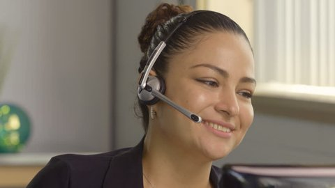 Customer service representative wearing headset talking to client