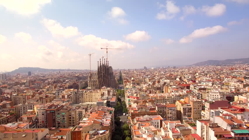 Sagrada Familia cathedral and Barcelona city aerial view in Spain, 4K drone footage.