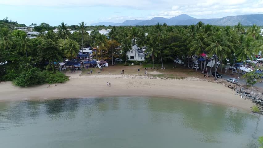 4K Aerial Footage coastal chapel bay - Port Douglas Wharf and Chapel Queensland Australia - back pan