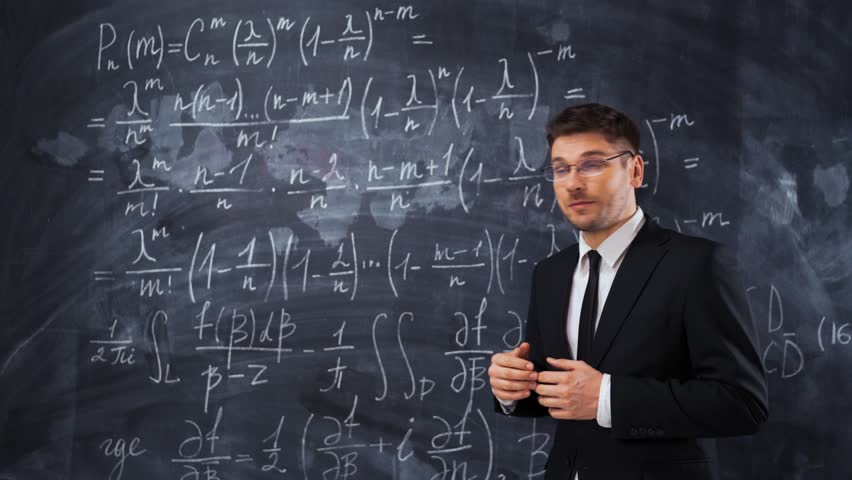 Young caucasian man teacher lecturer in formal suit and tie explaining decision of hard math equation. He invite You to study in university, smile and looks smart and clever.