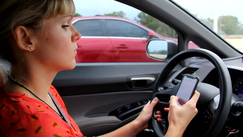 Woman texting while Driving #3019270