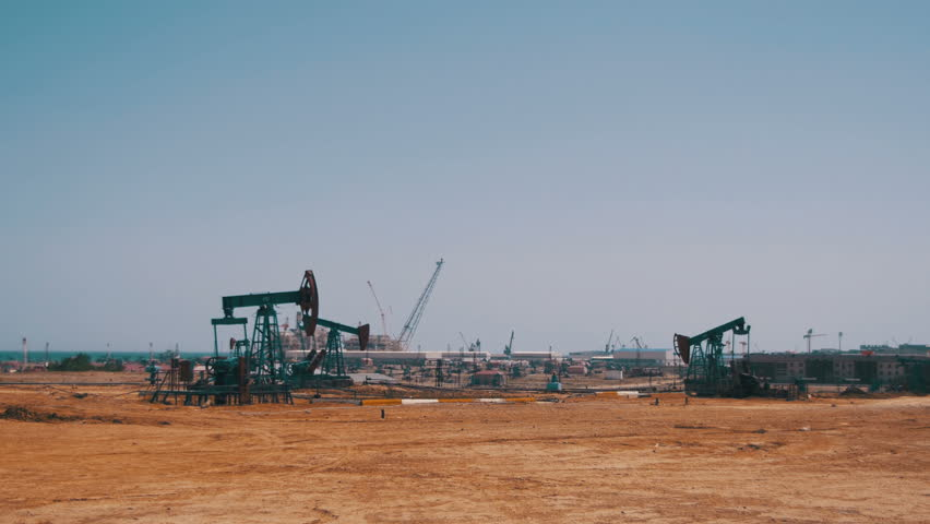 Oil Pump, Fossil Fuel Energy, Old Pumping Unit. Platform. Extraction of pumping station. Industrial oil pump jack working and pumping crude oil for fossil fuel energy with drilling rig in oil field.