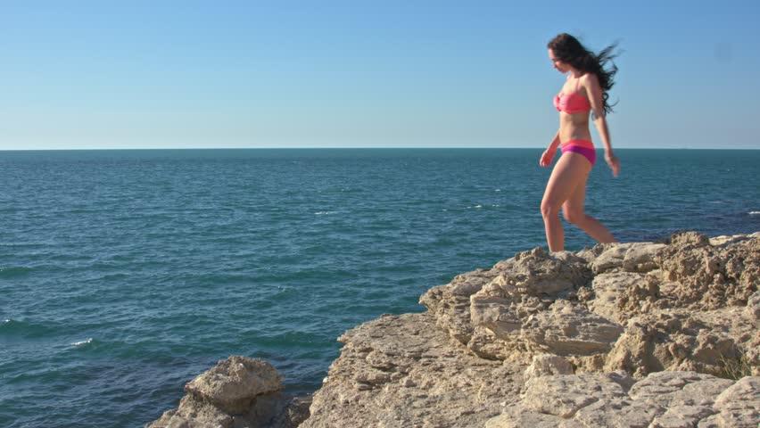 Girl on a rock by the sea | Shutterstock HD Video #30226153