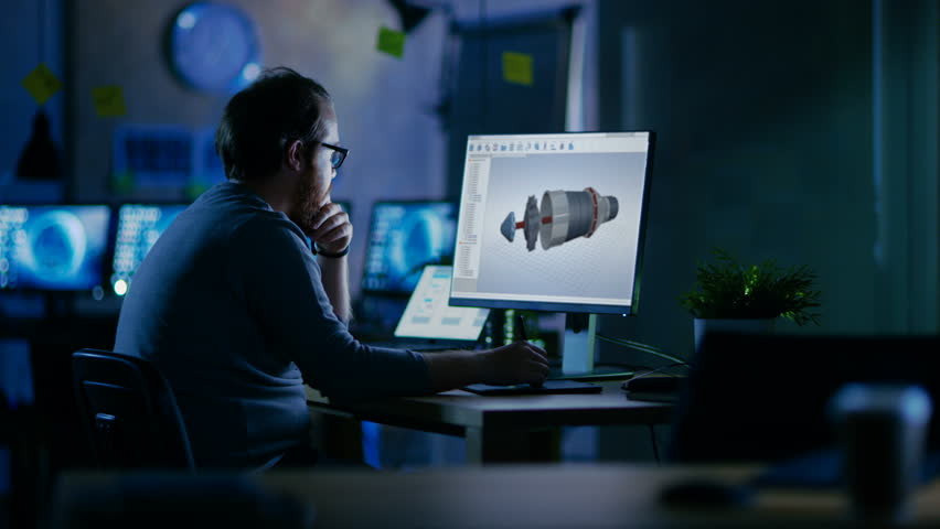 Young Bearded Engineer Works on a 3D Model Of Industrial Turbine. It's Late at Night He's the Only One Left on the Dark Office. Shot on RED EPIC-W 8K Helium Cinema Camera. | Shutterstock HD Video #30235195