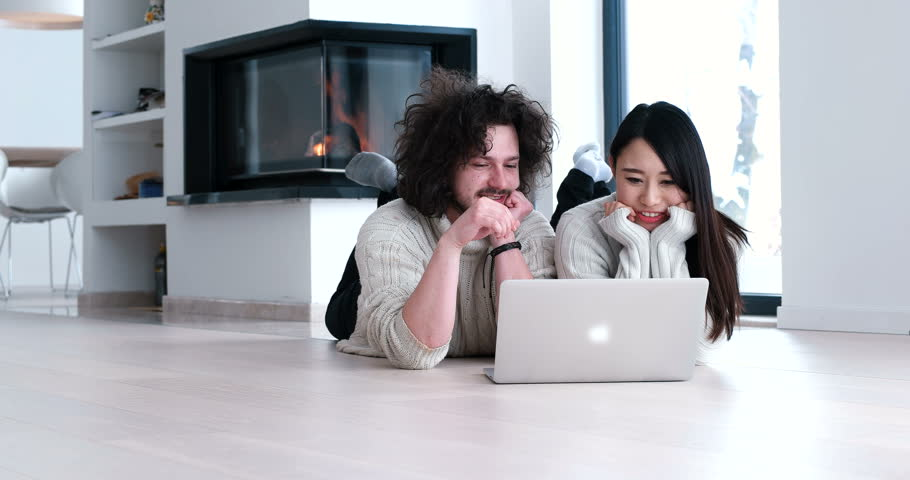 Young couple lying on the floor with digital tablet | Shutterstock HD Video #30241240