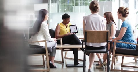 Businesswoman in a meeting using a digital tablet