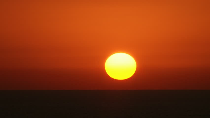 Beautiful Sunrise / Sunset (if invertd) time-lapse. Sun closeup.