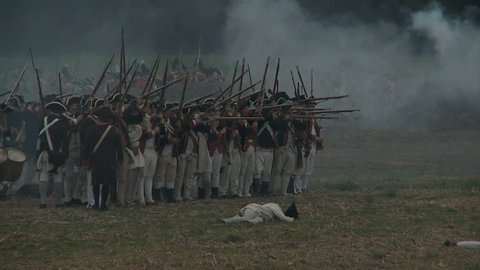 VIRGINIA - OCTOBER 2016 - Reenactment, large-scale, epic American Revolutionary War anniversary recreation - in the midst of battle.  Continental Army Americans fire muskets on British Soldiers. Smoke