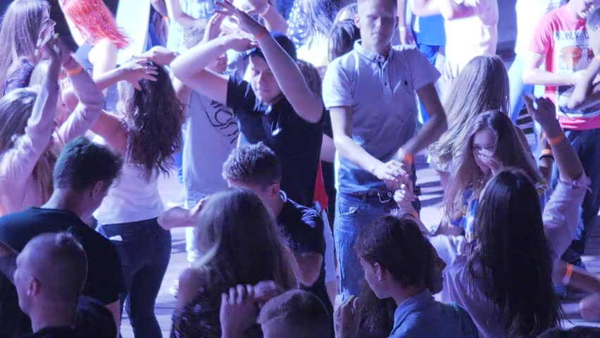 Skadovsk, Ukraine - 12 August 2017: many Youth with arms raised dancing and jumping in nightclub in Skadovsk, 12 August 2017. #30280450