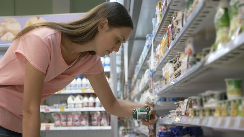 Young housewife in summer wear selecting dairy products in fridge at grocery department of shopping mall | Shutterstock HD Video #30291328