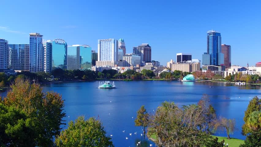 Orlando, Florida, USA downtown city skyline on Eola Lake, Orlando, Florida, USA -Aerial view Eola Lake fountain at Orlando downtown, Florida   Shutterstock HD Video #30324550