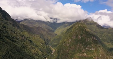 Aguas Calientes Peru Aerial v20 Flying high above town with mountain and Machu Picchu views