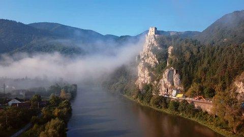 Flying around abandoned clifftop Strecno castle, Slovakia.
