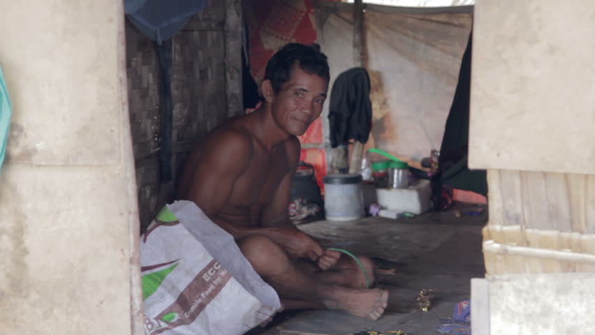 Adult man inside shack in a slum