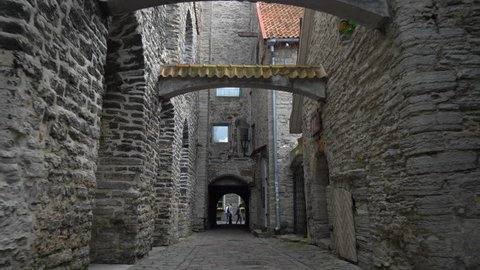 POV. Walking down the  dark street of old Tallinn, Estonia