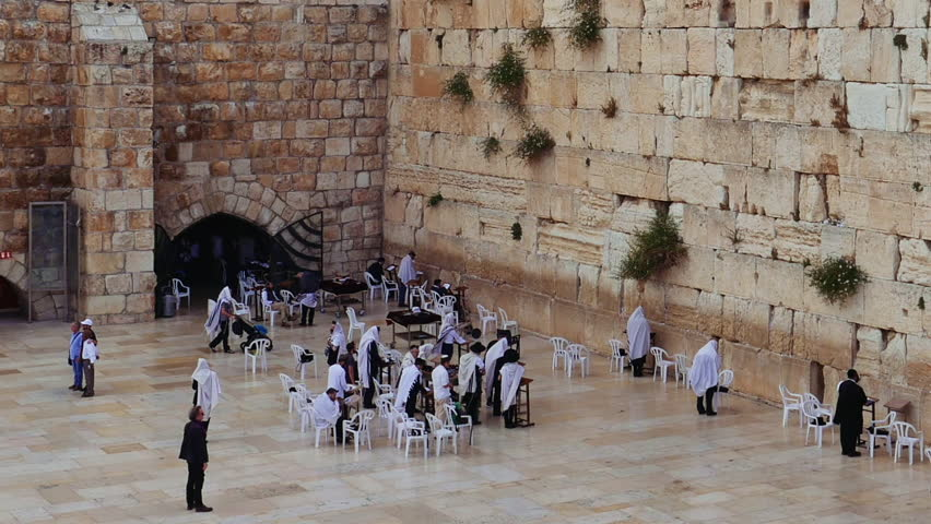 Western Wall or Wailing Wall or Kotel in Jerusalem. People come to pray to the Jerusalem western wall. The Wall is the most sacred place for all jews in the world.