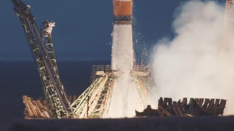 BAIKONUR, KAZAKHSTAN - JULE 28: Russian rocket take off. The spacecraft launches into space, the astronauts fly away from planet earth for docking in the International Space Station