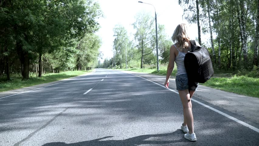 Young woman with backpack walking on the road back view. Young woman traveler with backpack walking on the road on summer day | Shutterstock HD Video #30453010