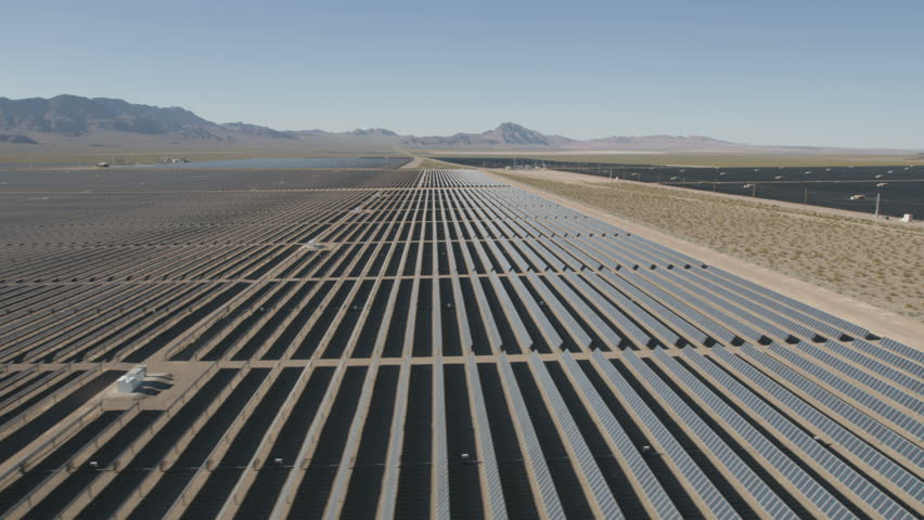 Aerial view Nevada Solar One Photovoltaic Solar units being used to produce natural clean energy for business industrial production Nevada USA RED WEAPON | Shutterstock HD Video #30458350