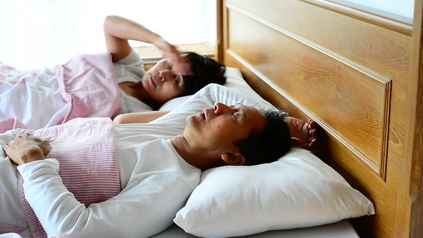 Man snoring loud and choking ,waking his wife up during the night,she pushing him to sleep on his side. Obstructive Sleep Apnea symptoms.