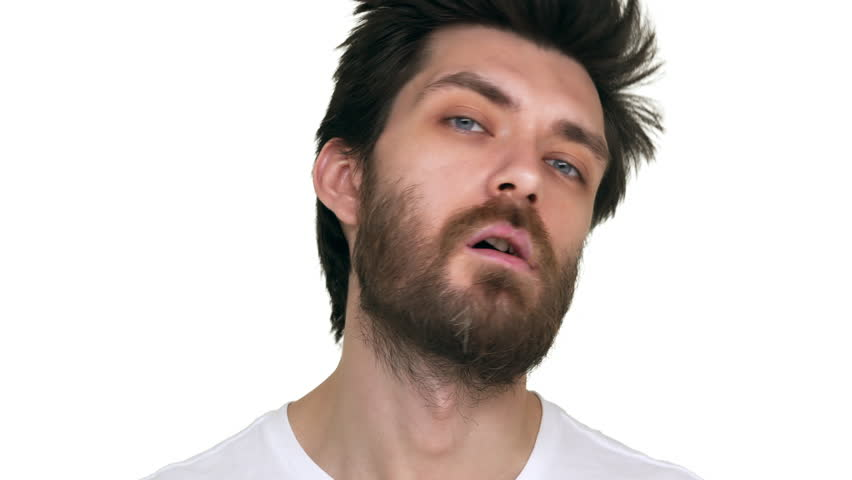 Young bearded man with a toothpick in mouth acting loose
