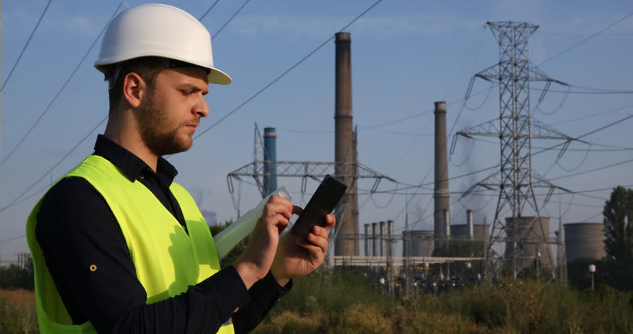 Energy Engineer Man Use Digital Tablet Look Up Power Plant Wire Lines Network