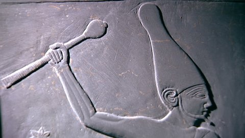 CAIRO, EGYPT - CIRCA 2002: Tilt-down from King Narmer wearing the White Crown of upper Egypt, wielding a mace in readiness to bludgeon a kneeling bearded enemy. Narmer Palette, Museum of Cairo.