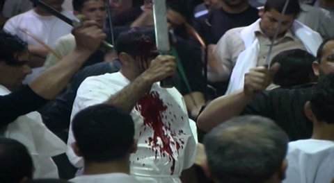 NABATIEH, LEBANON - CIRCA 2005: Ashura procession. Shia men performing Tatbir, an act of mourning which includes striking oneself with a sword causing blood to flow in remembrance of Hussain Ibn Ali.