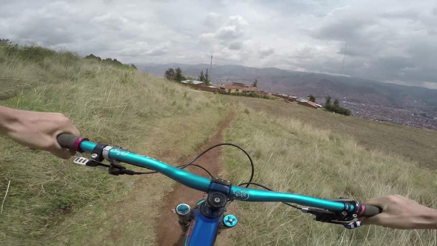 Mountain Biking At High Speed Over Gap Jumps With City And Mountain View In The Background   Shutterstock HD Video #30525730