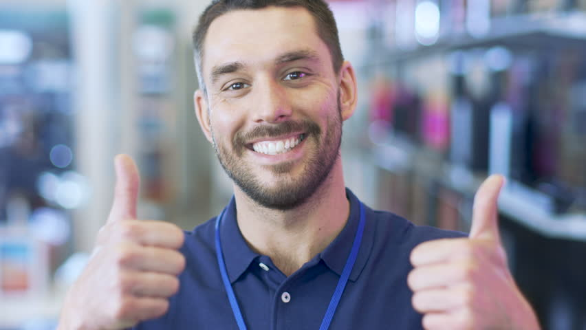 Young-Man-Smiling-And-Thumbs-Up Image - Free Stock Photo -1022