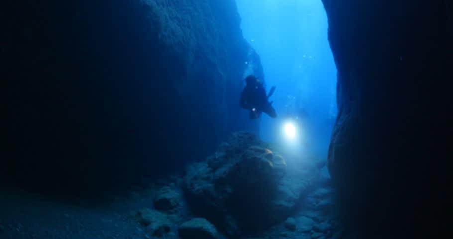 Cave diving underwater scuba divers exploring cave dive  | Shutterstock HD Video #30555625
