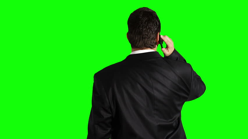Young Businessman Cell Phone Looking Up Greenscreen