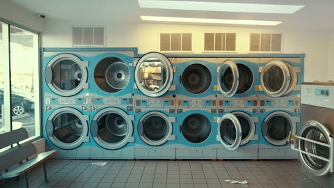 Video of self-service laundry - coin laundry washing machines and colourful laundry in 4k
