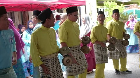 Seremban, Negeri Sembilan, Malaysia - 9/9/2017 : A group of teenagers playing a traditional music instrument called Cak Lempong,which is popular in Negeri Sembilan and originated from West Sumatra