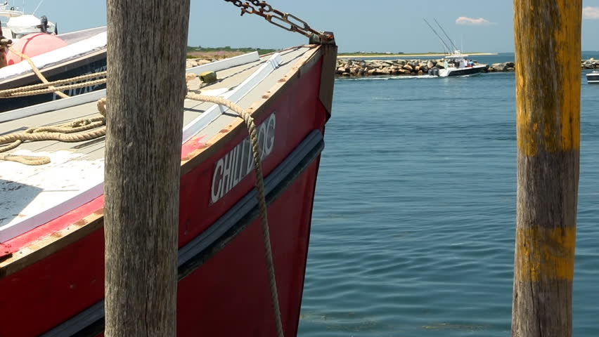 MENEMSHA HARBOR, MARTHA'S VINEYARD - JULY 14th;  Fishing boat waits along the dock of quaint fishing village July 14th, 2012 MENEMSHA, MA